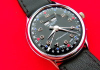 """Refinished dial with unusual color scheme on the hour markers, incorrect font, incorrect location for """"Swiss Made"""""""